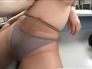 Lady in pantyhose is pleasured as man licks her tits