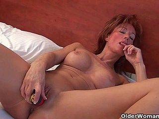 Sultry grandma Nina probes her old pussy with a dildo
